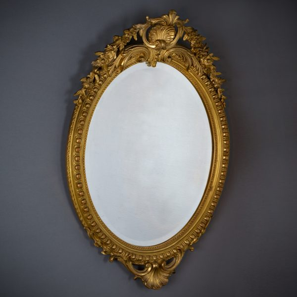 Ovale vergulde spiegel